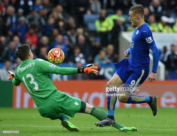 Jamie Vardy of Leicester City goes past Wayne Hennessey of Crystal Palace to score his team's first goal during the Barclays Premier League match...