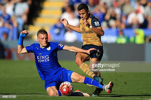 Jamie Vardy of Leicester City in action with Alexis Sanchez of Arsenal during the Barclays Premier League match between Leicester City and Arsenal at...