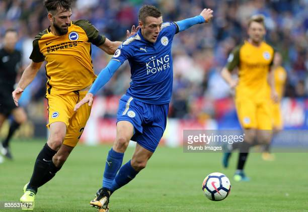 Jamie Vardy of Leicester City in action with Davy Propper of Brighton and Hove Albion during the Premier League match between Leicester City and...