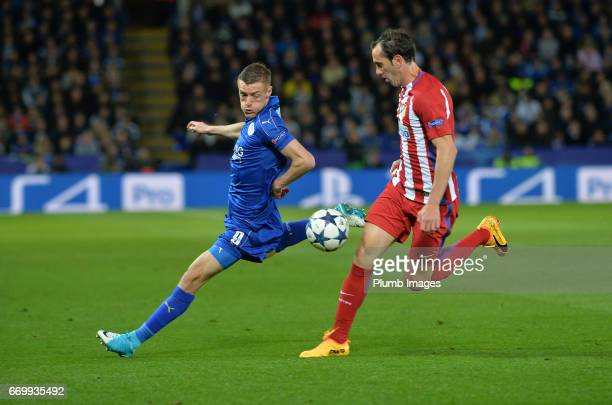 Jamie Vardy of Leicester City in action with Diego Godin of Atletico Madrid during the UEFA Champions League Quarter Final Second Leg match between...