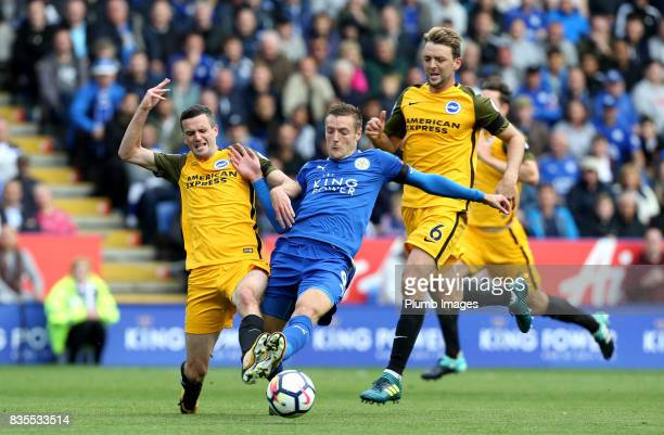 Jamie Vardy of Leicester City in action with Jamie Murphy of Brighton and Hove Albion during the Premier League match between Leicester City and...