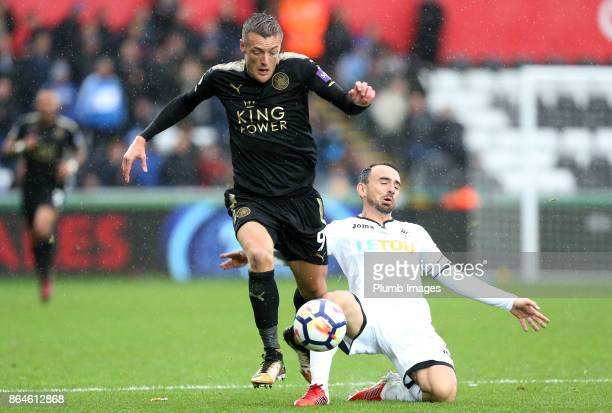 Jamie Vardy of Leicester City in action with Leon Britton of Swansea City during the Premier League match between Swansea City and Leicester City at...