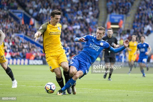 Jamie Vardy of Leicester City in action with Lewis Dunk of Brighton and Hove Albion during the Premier League match between Leicester City and...