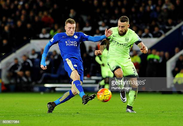 Jamie Vardy of Leicester City in action with Nicolas Otamendi of Manchester City during the Barclays Premier League match between Leicester City and...