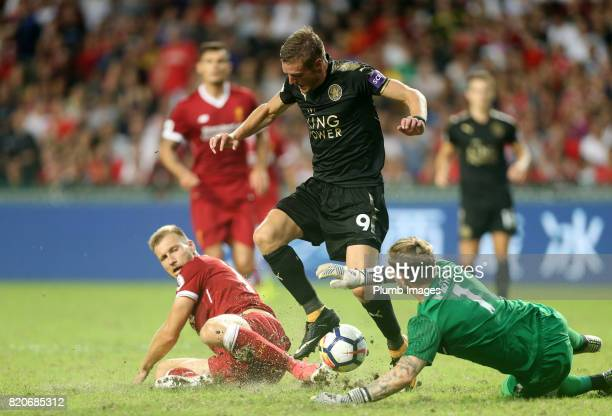 Jamie Vardy of Leicester City in action with Ragnar Klavan and Loris Karius of Liverpool during the Premier League Asia Trophy Final between...