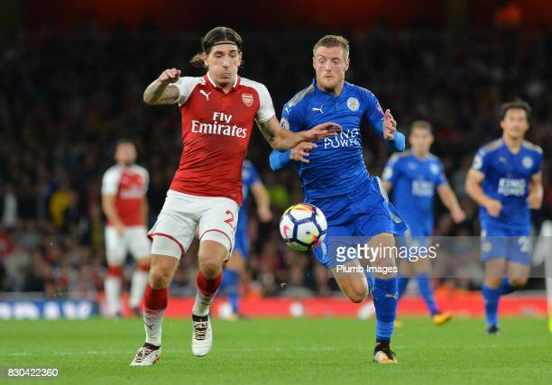 Jamie Vardy of Leicester City ion action with Hector Bellerin of Arsenal during the Premier League match between Arsenal and Leicester City at...