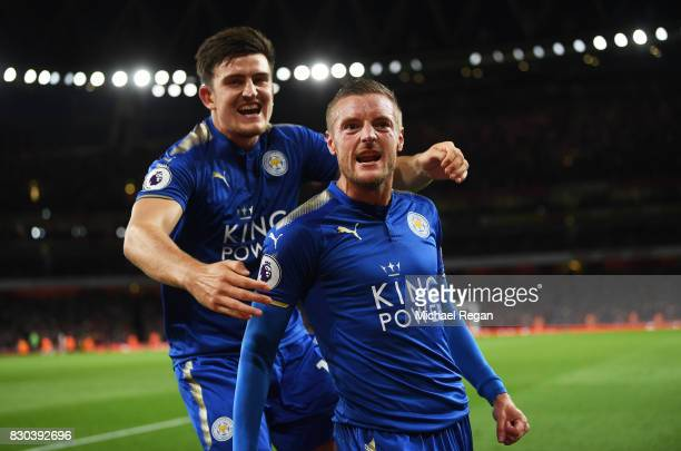 Jamie Vardy of Leicester City is congratulated by teammate Harry Maguire after scoring his team's third goal during the Premier League match between...