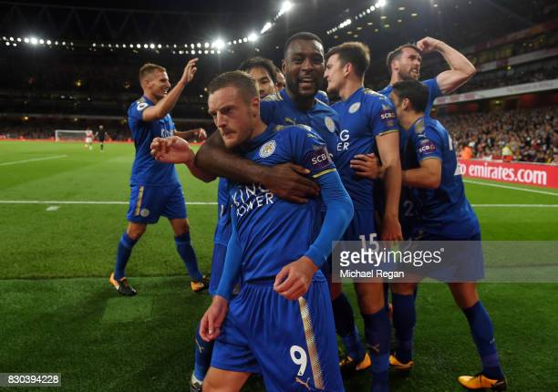Jamie Vardy of Leicester City is congratulated by teammate Wes Morgan after scoring his team's third goal during the Premier League match between...