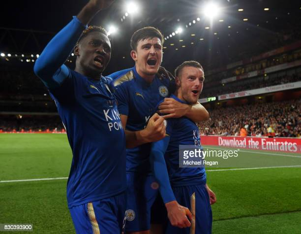 Jamie Vardy of Leicester City is congratulated by teammates Harry Maguire and Wilfred Ndidi after scoring his team's third goal during the Premier...