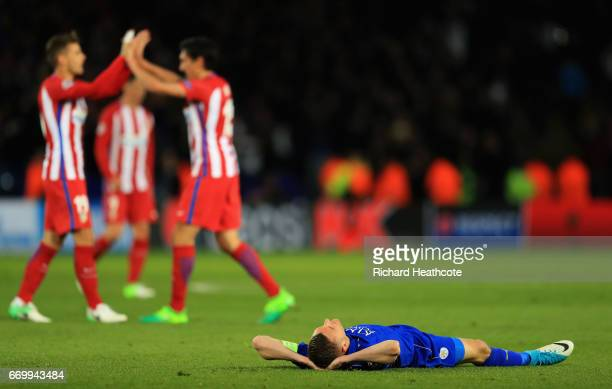 Jamie Vardy of Leicester City is dejected as the Atletico Madrid team cleberate after the UEFA Champions League Quarter Final second leg match...