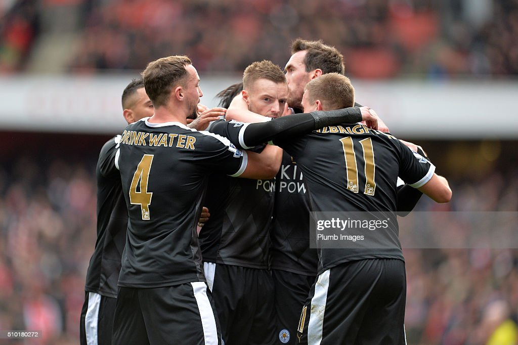 Jamie Vardy of Leicester City is mobbed by his team mates after scoring from the penalty spot to make it 0-1 during the Premier League match between Arsenal and Leicester City at Emirates Stadium on February 14, 2016 in London, United Kingdom.