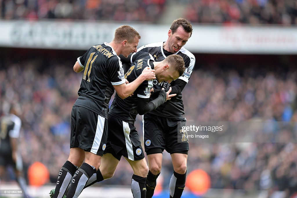 Jamie Vardy of Leicester City is mobbed Marc Albrighton and Christian Fuchs of Leicester City after scoring from the penalty spot to make it 0-1 during the Premier League match between Arsenal and Leicester City at Emirates Stadium on February 14, 2016 in London, United Kingdom.