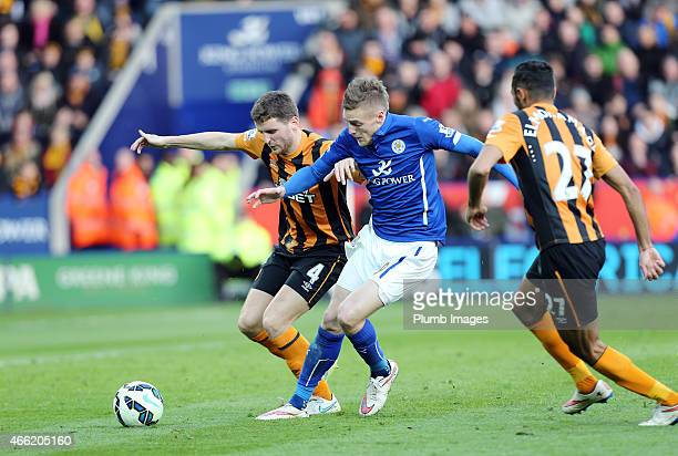 Jamie Vardy of Leicester City is muscled off the ball by Alex Bruce and Ahmed Elmohamady of Hull City during the Barclays Premier League match...