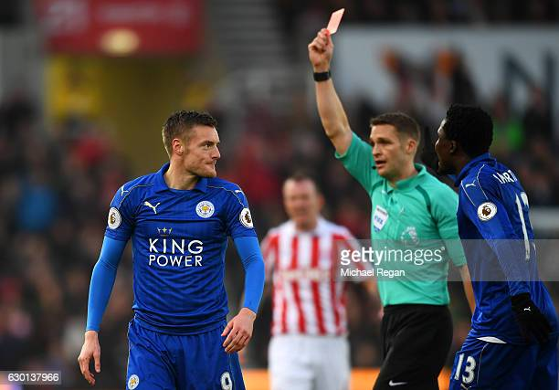 Jamie Vardy of Leicester City is shown a red card by referee Craig Pawson during the Premier League match between Stoke City and Leicester City at...