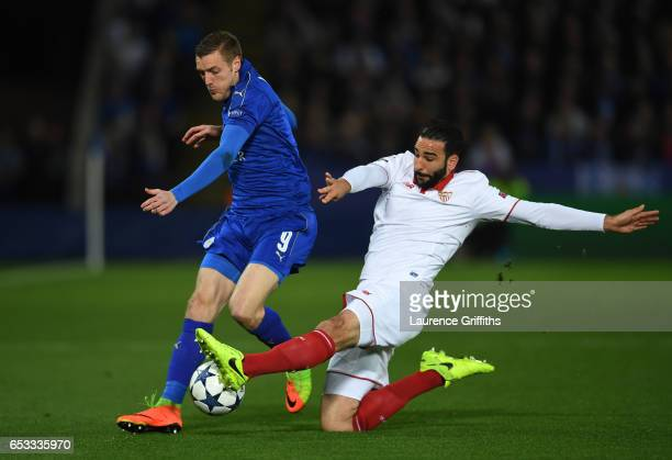 Jamie Vardy of Leicester City is tackled by Adil Rami of Sevilla during the UEFA Champions League Round of 16 second leg match between Leicester City...