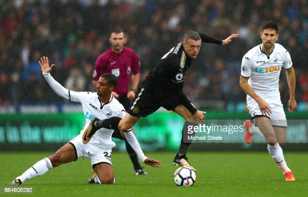 Jamie Vardy of Leicester City is tackled by Kyle Naughton of Swansea City during the Premier League match between Swansea City and Leicester City at...