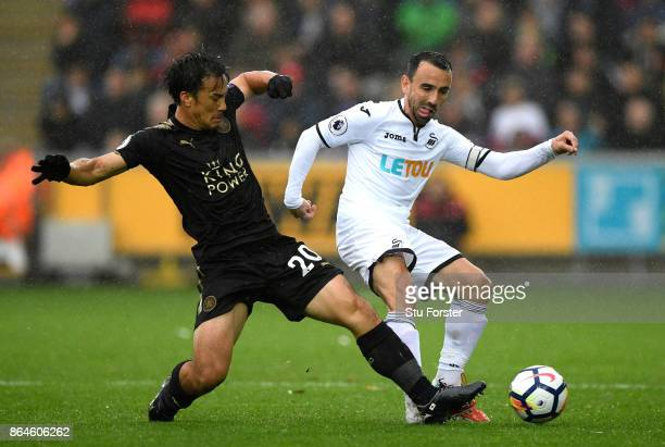 Jamie Vardy of Leicester City is tackled by Leon Britton of Swansea City during the Premier League match between Swansea City and Leicester City at...