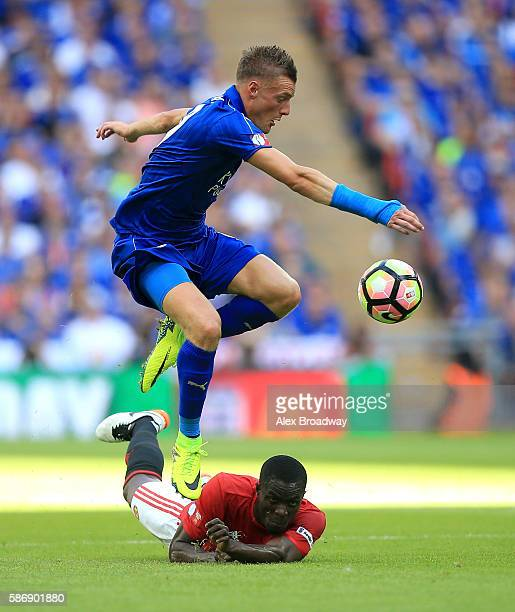 Jamie Vardy of Leicester City jumps the ball over Eric Bailly of Manchester United during The FA Community Shield match between Leicester City and...