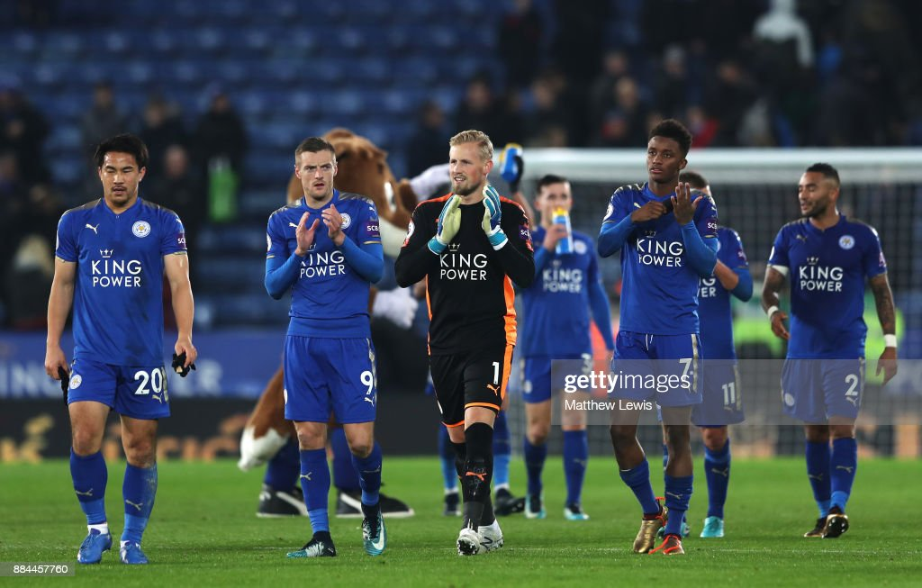 Jamie Vardy of Leicester City, Kasper Schmeichel of Leicester City and Demarai Gray of Leicester City show appreciation to the fans after the Premier League match between Leicester City and Burnley at The King Power Stadium on December 2, 2017 in Leicester, England.