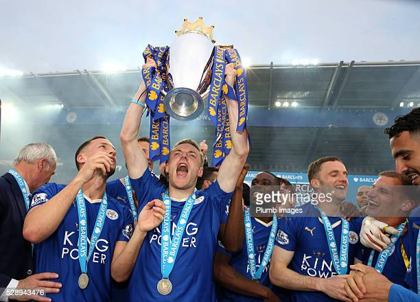 Jamie Vardy of Leicester City lifts the Premier League trophy after the Barclays Premier League match between Leicester City and Everton at the King...