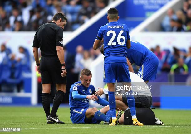 Jamie Vardy of Leicester City receives treatment from the medical team during the Premier League match between Leicester City and Brighton and Hove...