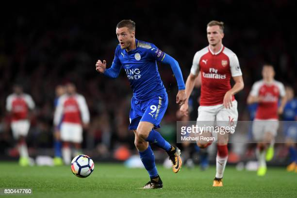 Jamie Vardy of Leicester City runs with the ball during the Premier League match between Arsenal and Leicester City at the Emirates Stadium on August...