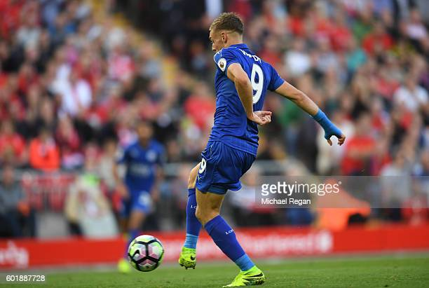 Jamie Vardy of Leicester City scores his sides first goal during the Premier League match between Liverpool and Leicester City at Anfield on...