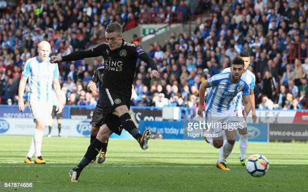 Jamie Vardy of Leicester City scores his sides first goal from the penalty spot during the Premier League match between Huddersfield Town and...