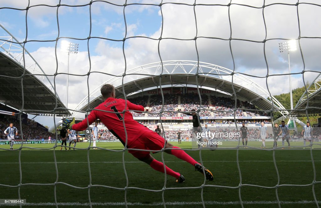 Jamie Vardy of Leicester City scores his sides first goal from the penalty spot past Jonas Lossl of Huddersfield Town during the Premier League match between Huddersfield Town and Leicester City at John Smith's Stadium on September 16, 2017 in Huddersfield, England.