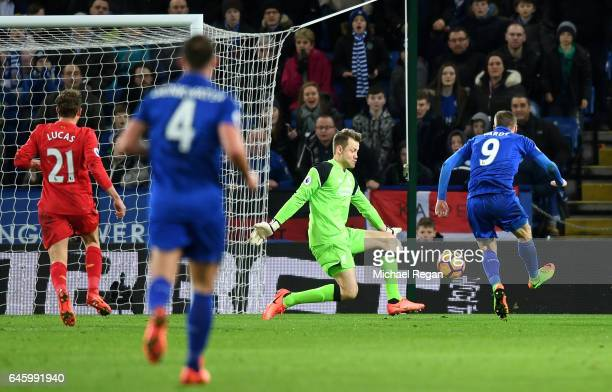 Jamie Vardy of Leicester City scores his sides first goal past Simon Mignolet of Liverpool during the Premier League match between Leicester City and...