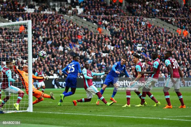Jamie Vardy of Leicester City scores his sides third goal during the Premier League match between West Ham United and Leicester City at London...