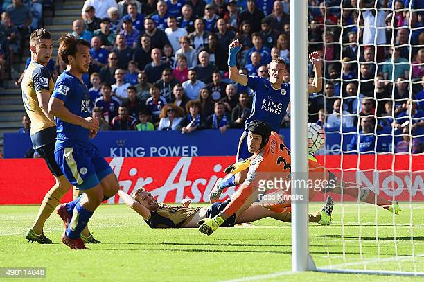 Jamie Vardy of Leicester City scores his team's first goal past Petr Cech of Arsenal during the Barclays Premier League match between Leicester City...