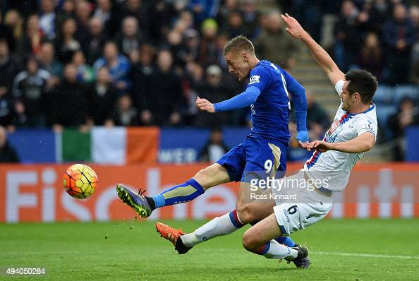 Jamie Vardy of Leicester City scores his team's opening goal during the Barclays Premier League match between Leicester City and Crystal Palace at...