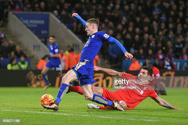 Jamie Vardy of Leicester City scores his team's second goal while Dejan Lovren of Liverpool tries to block during the Barclays Premier League match...