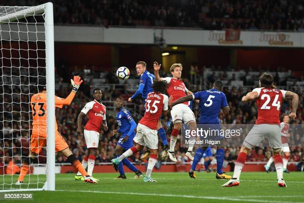 Jamie Vardy of Leicester City scores his team's third goal during the Premier League match between Arsenal and Leicester City at the Emirates Stadium...
