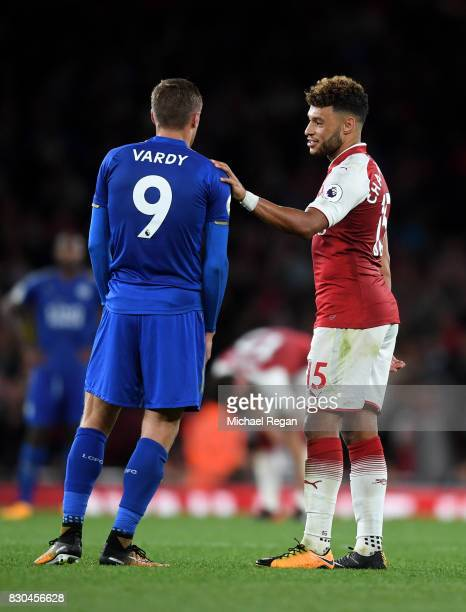Jamie Vardy of Leicester City speaks with Alex OxladeChamberlain of Arsenal following the final whistle during the Premier League match between...