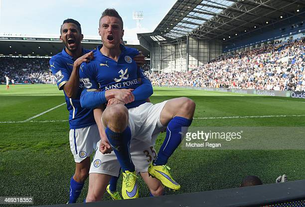 Jamie Vardy of Leicester City with Riyad Mahrez of Leicester City celebrates scoring the third goal with team mates during the Barclays Premier...