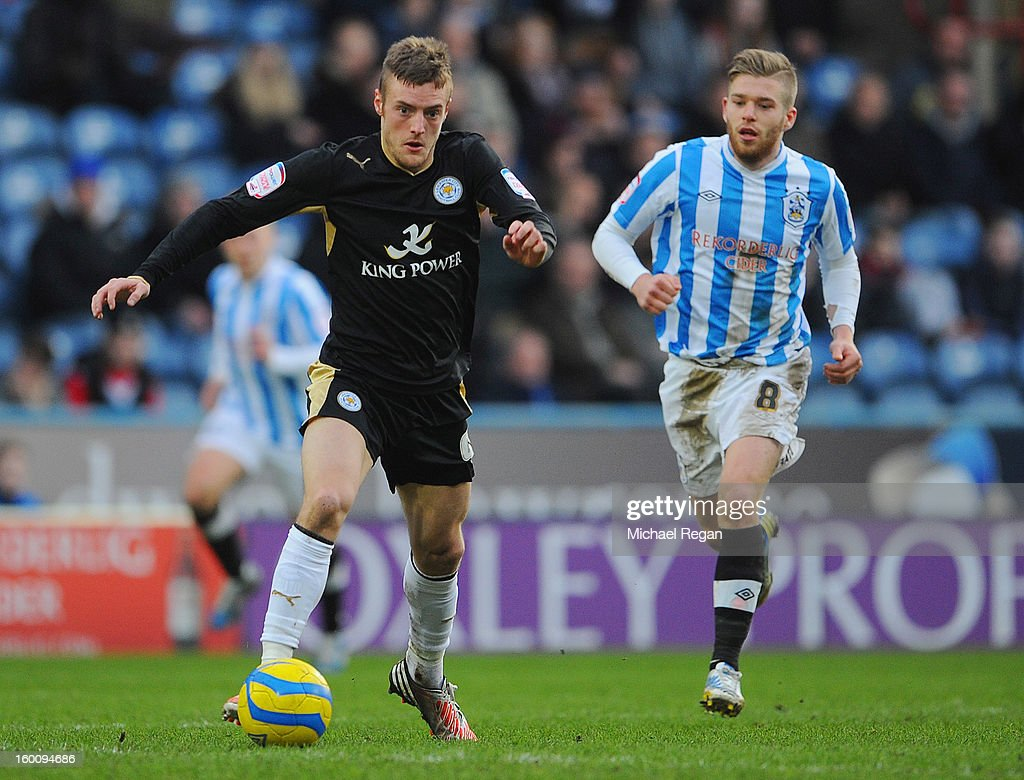 <a gi-track='captionPersonalityLinkClicked' href=/galleries/search?phrase=Jamie+Vardy&family=editorial&specificpeople=8695606 ng-click='$event.stopPropagation()'>Jamie Vardy</a> of Leicester in action with Adam Clayton of Huddersfield during the FA Cup Fourth Round match between Huddersfield Town and Leicester City at the Galpharm Stadium on January 26, 2013 in Huddersfield, England.