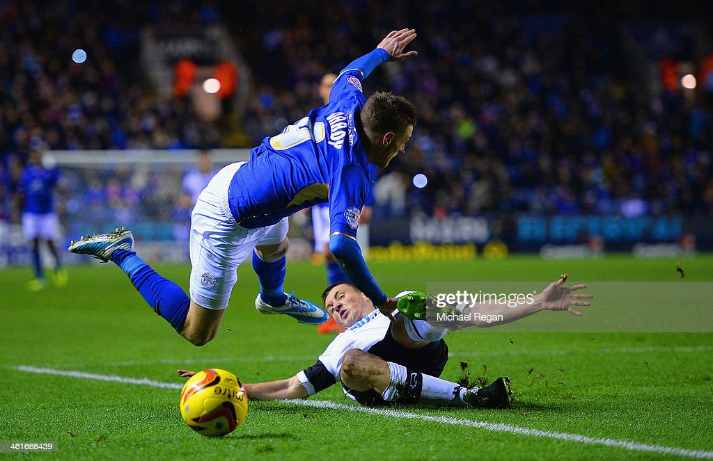 <a gi-track='captionPersonalityLinkClicked' href=/galleries/search?phrase=Jamie+Vardy&family=editorial&specificpeople=8695606 ng-click='$event.stopPropagation()'>Jamie Vardy</a> of Leicester is fouled by Craig Forsyth of Derby to conceed a penalty during the Sky Bet Championship match between Leicester City and Derby County at The King Power Stadium on January 10, 2014 in Leicester, England.