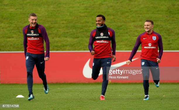 Jamie Vardy Ryan Bertrand and Kieran Trippier of England in action during a England training session at St Georges Park on November 9 2017 in...