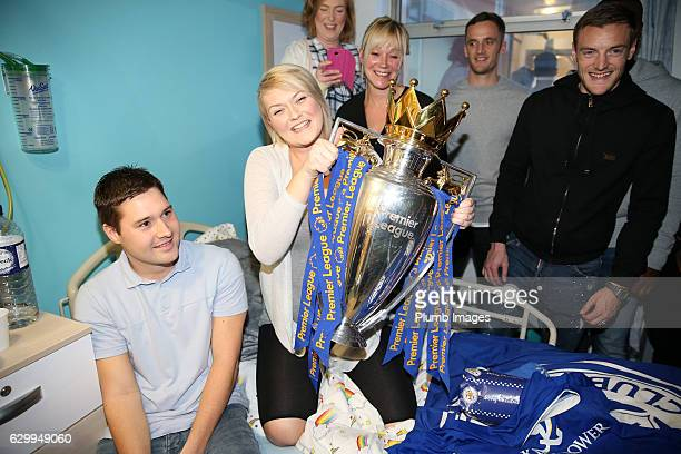 Jamie Vardy shows off the Premier League trophy during the Leicester City Players Deliver Christmas Presents to Patients at Leicester Royal Infirmary...