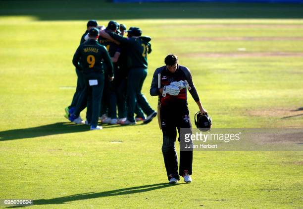 Jamie verton of Somerset walks off as Nottinghamshire Outlaw players celebrate victory during The Royal London OneDay Cup Play Off match between...