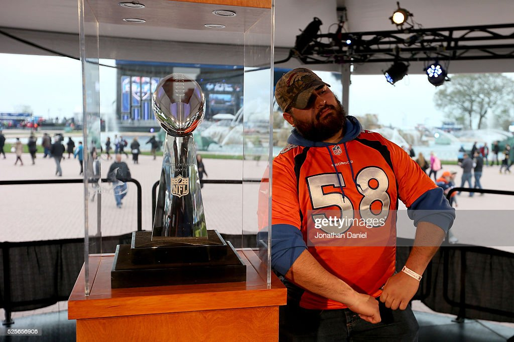 Jamie Villa of Glenwood Springs, CO poses with the Vince Lombardi Trophy at the Draft Town prior to the 2016 NFL Draft at Grant Park on April 28, 2016 in Chicago, Illinois.