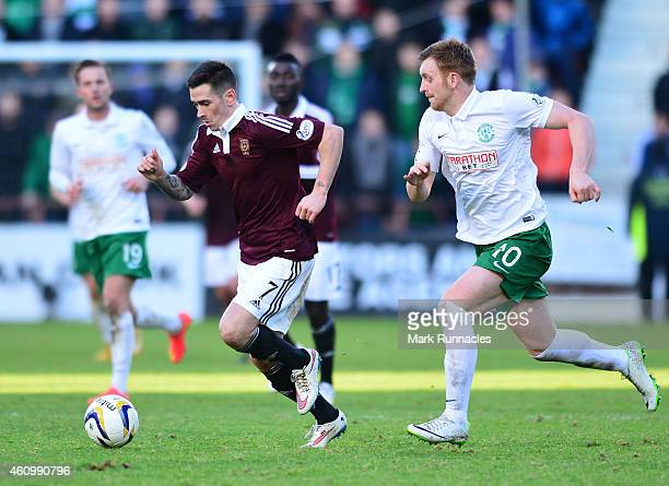 Jamie Walker of Hearts takes on Liam Craig of Hibernian during the Scottish Championship match between Heart of Midlothian FC and Hibernian FC at...