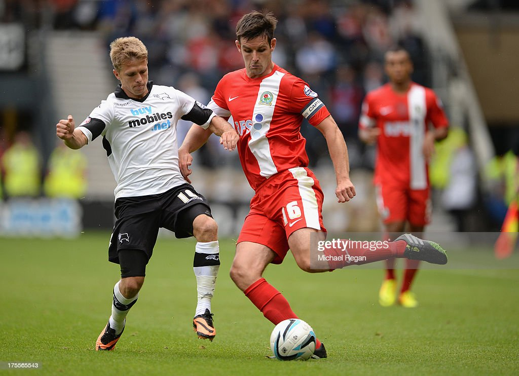 Jamie Ward of Derby challenges Scott Dann of Blackburn during the Sky Bet Championship match between Derby County and Blackburn Rovers at Pride Park Stadium on August 04, 2013 in Derby, England,