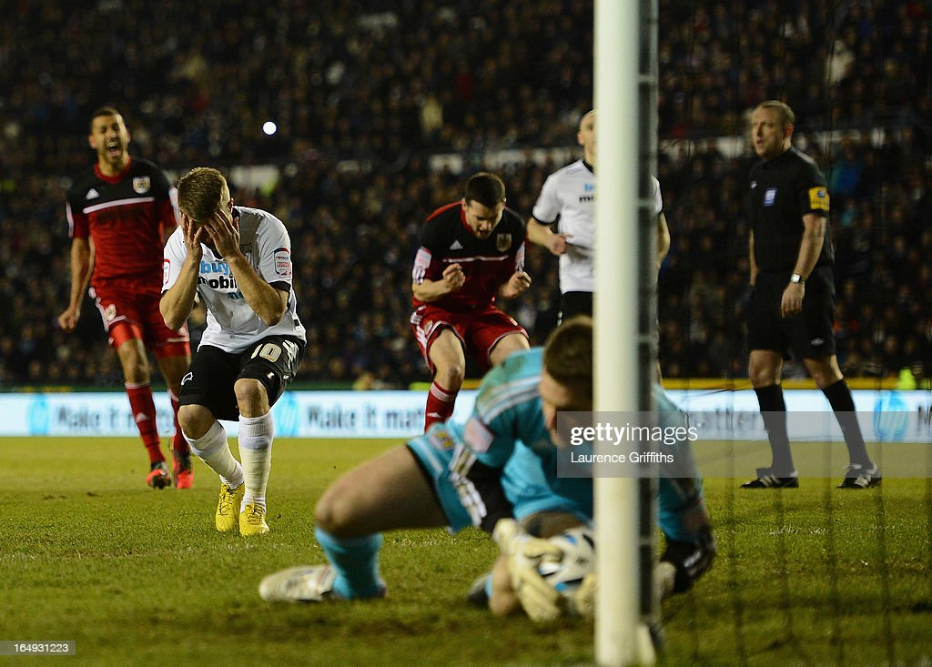 Jamie Ward of Derby County has a penalty saved by Tom Heaton of Bristol City during the npower Championship match between Derby County and Bristol City at Pride Park Stadium on March 29, 2013 in Derby, England.
