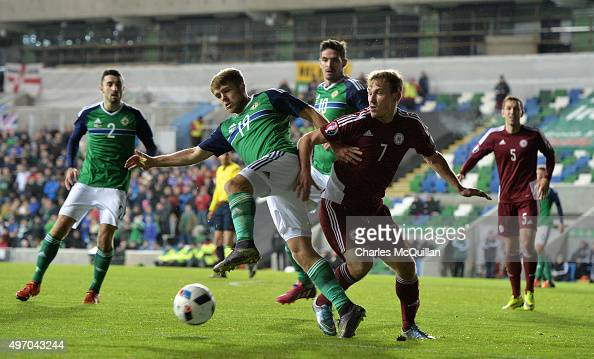 Jamie Ward of Northern Ireland and Aleksejs Visnakovs of Latvia tussle for the ball during the international football friendly at Windsor Park on...