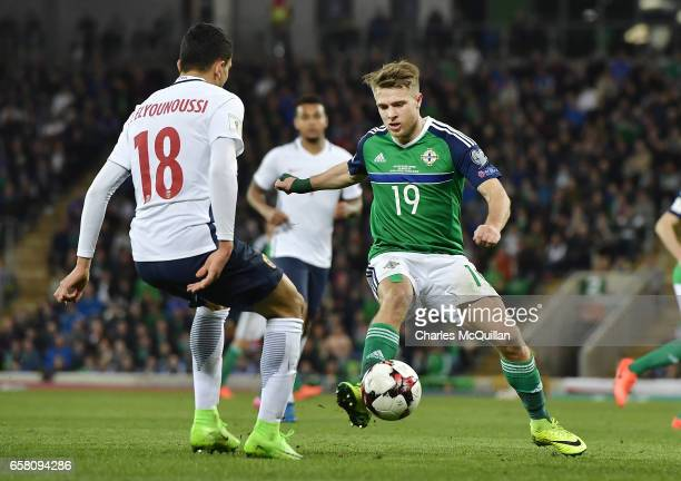 Jamie Ward of Northern Ireland and Mohamed Elyounoussi of Norway during the FIFA 2018 World Cup Qualifier between Northern Ireland and Norway at...