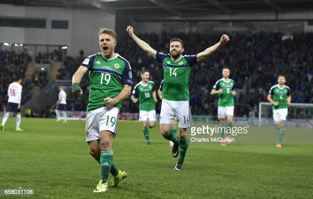 Jamie Ward of Northern Ireland celebrates scoring during the FIFA 2018 World Cup Qualifier between Northern Ireland and Norway at Windsor Park on...