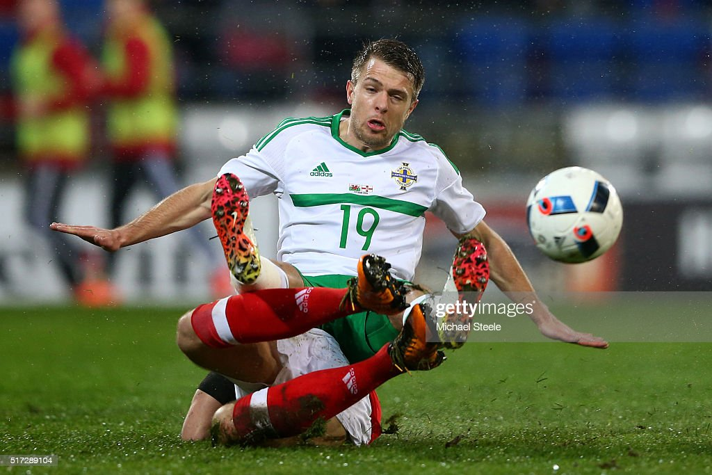 Jamie Ward of Northern Ireland is tackled by <a gi-track='captionPersonalityLinkClicked' href=/galleries/search?phrase=Adam+Matthews+-+Soccer+Player&family=editorial&specificpeople=11408041 ng-click='$event.stopPropagation()'>Adam Matthews</a> of Wales during the international friendly match between Wales and Northern Ireland at the Cardiff City Stadium on March 24, 2016 in Cardiff, Wales.